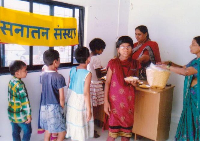 Distributing food-items to needy children