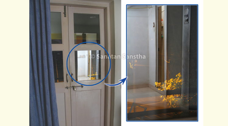 Reflection and transparency :  The glass on the balcony door of H.H. Dr Athavale's room has a high level of reflection & transparency. When viewing the road & tree lit up with yellow light from the street lamp through the glass, we can also see the clear reflection of the bathroom door.