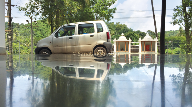 Flood like appearance : Due to the reflectivity and surface of the kota tiles rippling and the way this picture has been taken, it seems as if the car is wading through flood waters.