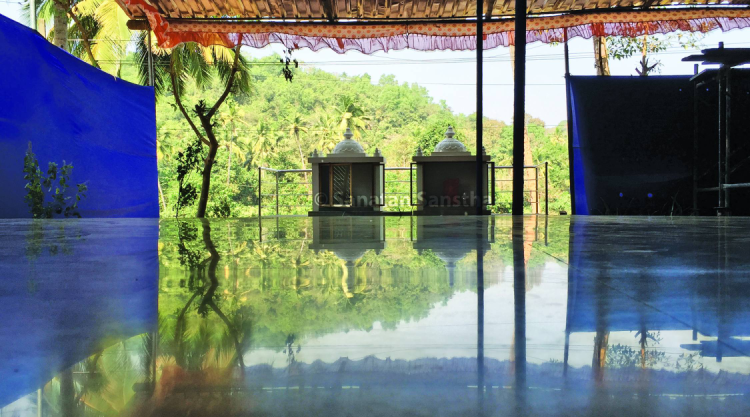 Watery lake like surface : Heightened reflection was seen in the front porch area of the Sanatan Ashram. The two temples and the landscape behind them can be clearly seen.