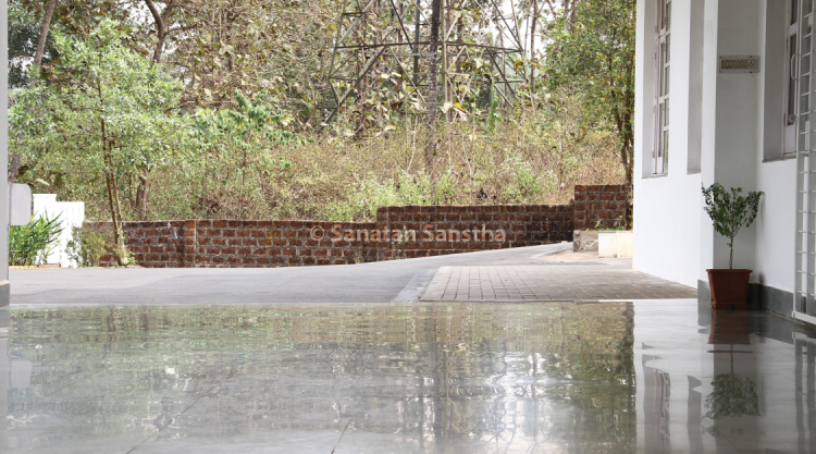 Highly reflective Ashram porch  : The front porch of the main entrance to the Sanatan Ashram is made of kota (limestone) tiles. Even though a minimum amount of finishing has been applied to the tiles, the surface has become highly reflective over the years.
