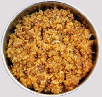 Offering jaggery mixed with grated coconut to God